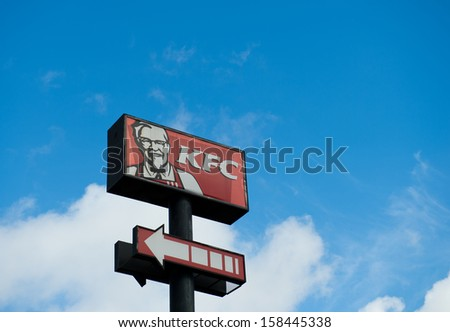FUJIAN, CHINA - JULY 26: KFC's logo on blue sky  on July. 26, 2013 in Fujian, China. Kentucky Fried Chicken Restaurant is the world's largest chain of hamburger and chicken fast food restaurants.