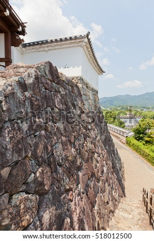 FUKUCHIYAMA, JAPAN - JULY 29, 2016: Stone walls (Ishigaki) of Fukuchiyama castle. Castle was erected in 1579 by Akechi Mitsuhide, abandoned in 19th c., reconstructed in 1985