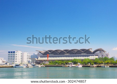 FUKUOKA, JAPAN - JUL 09: View of Hakata Port with Marine Messe Fukuoka on Jul 09, 2015 in Fukuoka, Japan. Marine Messe Fukuoka is arena facility that is used for many events and concerts.