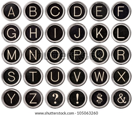 Full alphabet of vintage typewriter keys including dollar sign, ampersand, exclamation and question marks.  Each key is isolated on white with clipping path. - stock photo
