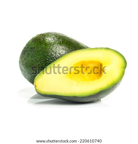 Full and cut in half avocado isolated on white background - stock photo