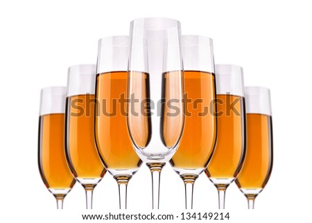 Full and empty champagne glasses with white wine