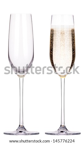 full and empty glass of champagne isolated on a white background - stock photo