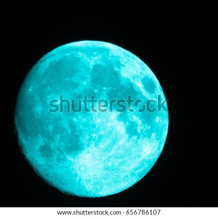Full aqua colored Moon phase 97%. Night view of the moon through a telescope. High resolution colored photo. Northern Hemisphere. Eastern Europe