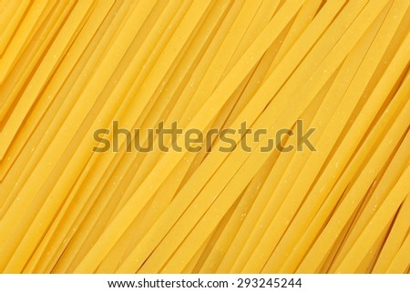 Full background of dried uncooked linguine pasta - stock photo