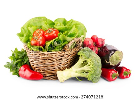 Full basket of ripe vegetables on white background - stock photo