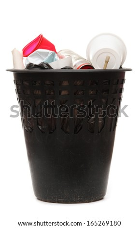 Full black wastebasket on white - stock photo