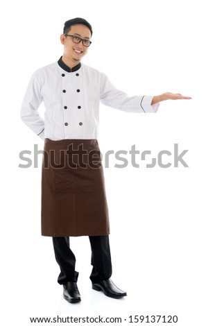 Full body Asian male chef hand showing blank space, standing isolated white background. - stock photo
