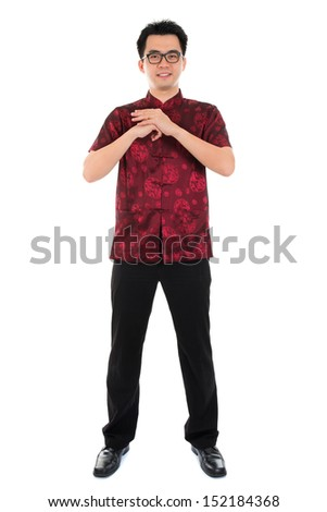 Full body Asian man with Chinese traditional dress cheongsam or tang suit greeting. Chinese new year concept, male model isolated on white background. - stock photo