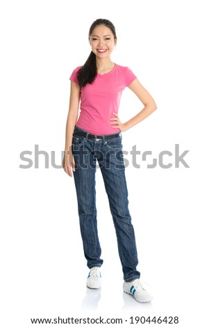 Full body Asian teen girl with pink shirt and jeans standing isolated on white background. - stock photo