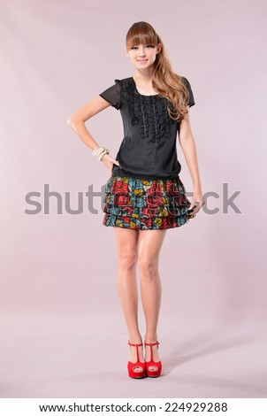 Full body Attractive young fashion model posing in the studio