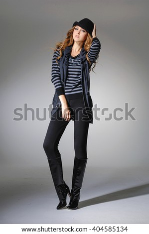 Full body Attractive young fashion model with hat posing in the light background