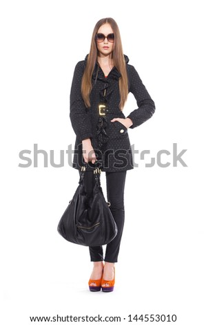 Full body attractive young girl in sunglasses with bag posing - stock photo