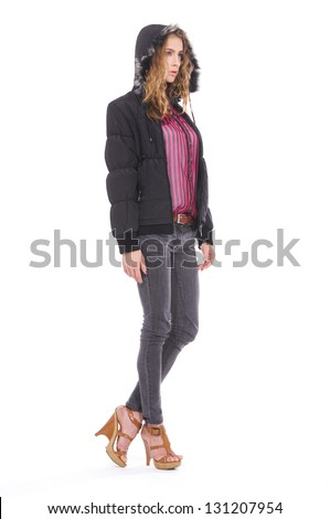 Full body attractive young girl standing against white background