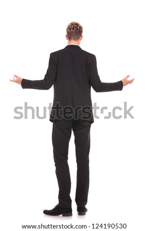 full body back view of a business man welcoming you on white background - stock photo