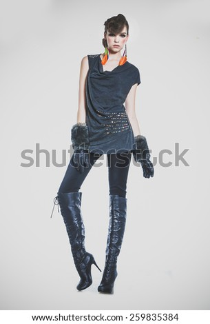 Full body beautiful high fashion model in modern clothes posing - stock photo