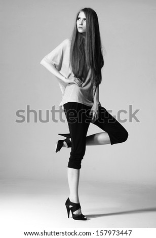 Full body beautiful woman in high heels and jeans, isolated , black and white photo