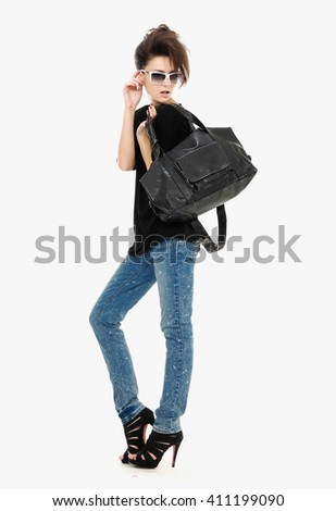 Full body beautiful young woman in jeans with sunglasses posing - stock photo