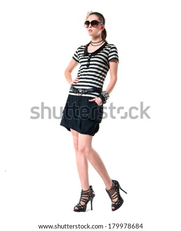 Full body beautiful young woman in sunglasses posing on white
