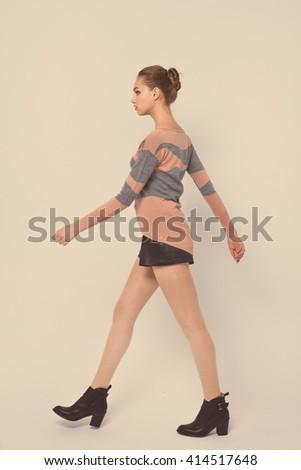 Full body beautiful young woman walking-  retro background - stock photo