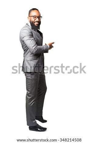 full body business black man doing a welcome gesture - stock photo