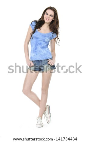 Full body casual young fashion mode in short jeans posing