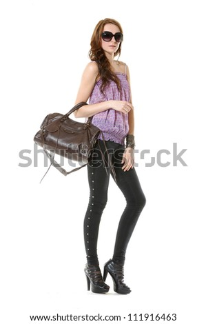Full body casual young fashion mode in sunglasses with handbag
