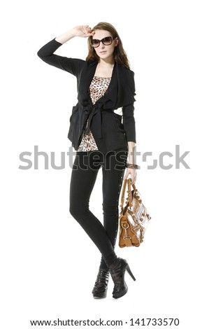 Full body casual young fashion mode in sunglasses with handbag - stock photo