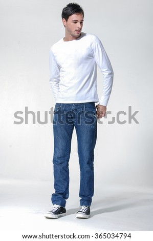 Full body Casual young man iin jeans standing - isolated  - stock photo