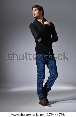 Full body Casual young man in jeans â??light background - stock photo