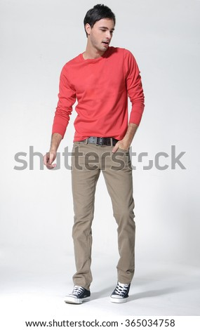 Full body casual young man in red shirt looking posing - stock photo
