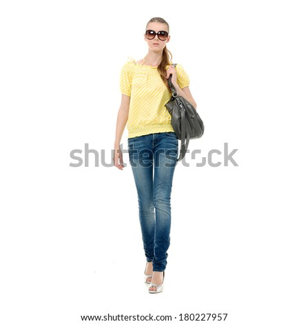 Full body fashion girl in sunglasses and in jeans show in studio,