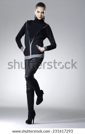 Full body fashion model posing on gray background