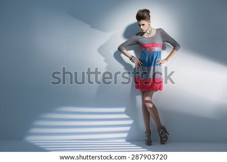 Full body fashion model wearing modern posing in studio - stock photo