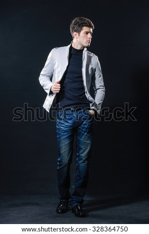 Full body Fashion Shot of a young man a professional model posing in studio - stock photo