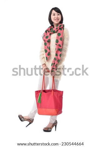 Full body Fashion woman holding a personal big bag - stock photo