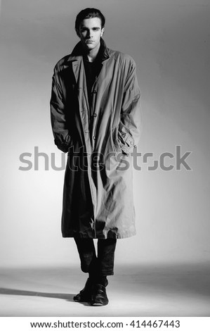 Full body Fashion young man in coat on light background