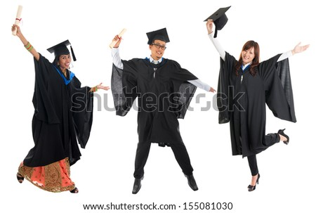 Full body group of multi races university student in graduation gown jumping isolated on white background - stock photo