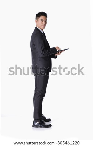 Full body Happy Young Businessman Using Digital Tablet Isolated