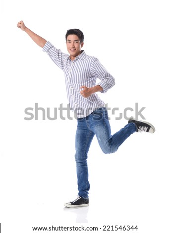 Full body Happy young man with arms up isolated - stock photo