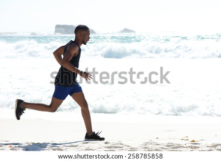 Full body healthy young man exercise jogging at the beach - stock photo