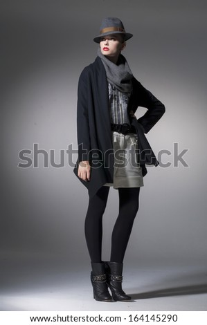 Full body High fashion model in hat posing in light background - stock photo