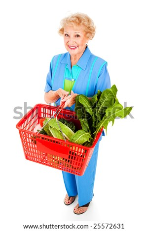 Full body isolated view of a beautiful healthy senior woman shopping for fresh produce. - stock photo