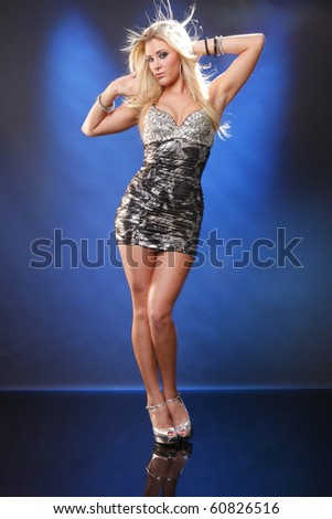 Full body of a blond in silver - stock photo