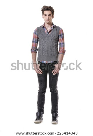 full body of a fashion man in jeans posing
