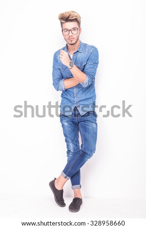 full body of a serious casual man wearing jeans clothes on white background - stock photo