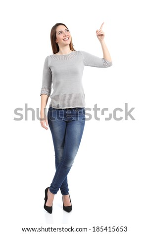Full body of a standing casual woman pointing at side isolated on a white background