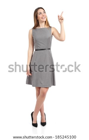Full body of a standing woman pointing at side isolated on a white background          - stock photo