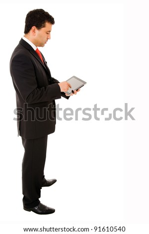 Full body of a young businessman using a tablet pc on white background - stock photo