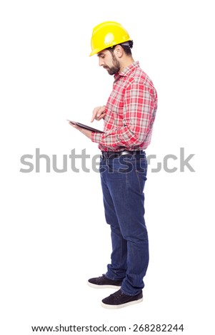 Full body of an architect holding a tablet computer, isolated on white background